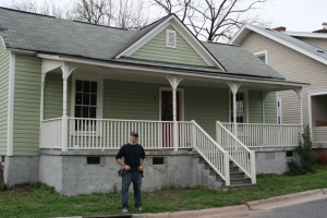 Jordan Caps works on restoring the interior of his new home at 1003 Worth Street, across the way from Golden Belt